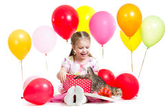 Surprised child with kitten in gift box Royalty Free Stock Images
