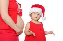 Surprised child and pregnant woman belly at Christmas Royalty Free Stock Photo