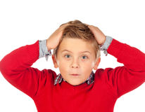 Surprised child with red jersey and his hands on the head Royalty Free Stock Images