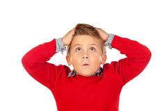 Surprised child with red jersey and his hands on the head Royalty Free Stock Photo