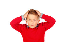 Surprised child with red jersey and his hands on the head Royalty Free Stock Photography