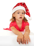 Surprised child in Santa Claus hat. Royalty Free Stock Image