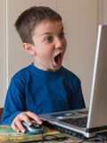 Surprised Child With Touch Screen Laptop Stock Photos