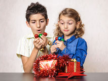 Surprised children Christmas present decorations Stock Image