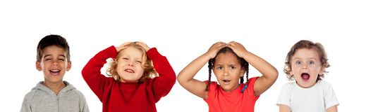 Surprised children covering their head and other laughing royalty free stock photography