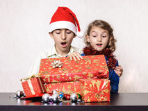 Surprised children looking in Christmas present box Stock Photos
