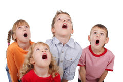 Surprised by children looking up Stock Photos