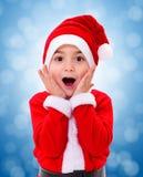 Surprised Christmas boy wondering Stock Photos