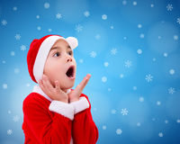 Surprised Christmas boy wondering Royalty Free Stock Images
