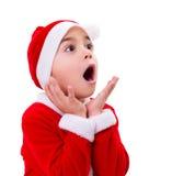 Surprised Christmas boy wondering Stock Photo