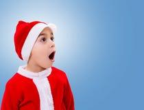 Surprised Christmas boy wondering Royalty Free Stock Photos