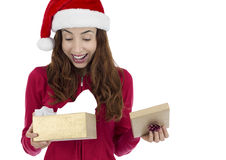 Surprised christmas gift woman. Christmas woman surprised by her christmas gifts Royalty Free Stock Images