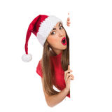 Surprised christmas girl behind a placard Royalty Free Stock Image