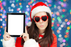 Surprised Christmas Girl with Heart Sunglasses and Tablet Stock Photo