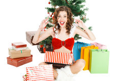surprised christmas girl isolated on white background with gift box Stock Image