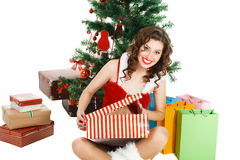 surprised christmas girl isolated on white background with gift box Royalty Free Stock Photos