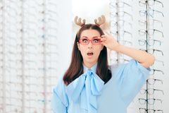 Surprised Christmas Girl in Optical Store on Sale Season stock image