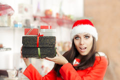 Surprised Christmas Girl with Presents in Gift Shop Stock Photography