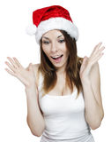 Surprised christmas girl. Surprised pretty girl in a christmas hat on white Royalty Free Stock Photos