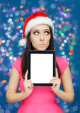 Surprised Christmas Girl with Tablet Royalty Free Stock Photography