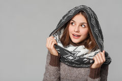 Surprised christmas girl wearing knitted wear scarf. Excited beautiful smiling girl, winter concept,  Stock Photos