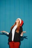 Surprised christmas girl wearing a santa hat Royalty Free Stock Photos