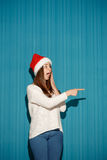 Surprised christmas girl wearing a santa hat Royalty Free Stock Images