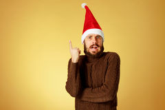 Surprised christmas man wearing a santa hat Stock Photography