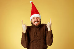 Surprised christmas man wearing a santa hat Stock Photos
