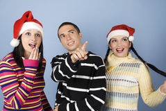 Surprised Christmas people faces looking up Stock Photos