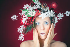 Surprised Christmas winter woman with tree hairstyle and makeup Royalty Free Stock Photos