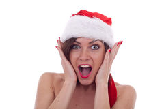 Surprised christmas woman Stock Images