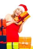 Surprised Christmas woman exploring gift Stock Image
