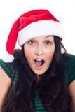 Surprised Christmas woman face. Surprised woman in Christmas hat, isolated on white background Stock Photo