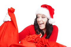 Surprised christmas woman isolated over white. Surprised christmas woman holding present isolated over white background Stock Images