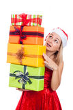 Surprised Christmas woman with many presents Royalty Free Stock Photo