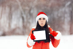 Surprised Christmas Woman Pointing to Tablet Screen Royalty Free Stock Image