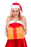 Surprised Christmas woman with present Royalty Free Stock Photos