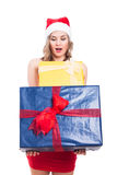 Surprised Christmas woman with presents Royalty Free Stock Photo