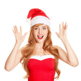 Surprised christmas woman in a santa hat smiling. Surprised christmas woman wearing a santa hat smiling isolated over a white background Royalty Free Stock Photos