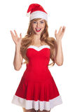 Surprised christmas woman wearing a santa hat. Smiling isolated over a white background Royalty Free Stock Image