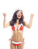 Surprised christmas woman wearing a santa hat smiling Stock Photography