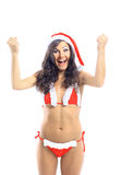 Surprised christmas woman wearing a santa hat smiling Royalty Free Stock Image