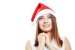 Surprised christmas woman. Wearing a santa hat smiling isolated over a white background Royalty Free Stock Photo