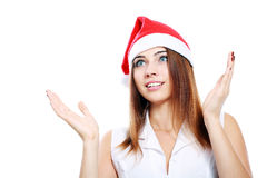 Surprised christmas woman. Wearing a santa hat smiling isolated over a white background Royalty Free Stock Image