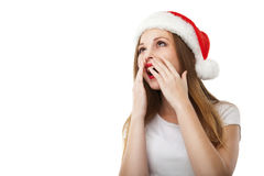 Surprised christmas woman wearing santa hat Royalty Free Stock Photos