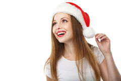 Surprised christmas woman wearing santa hat Stock Photo
