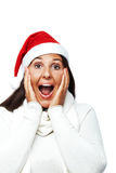 Surprised christmas woman. Young woman with santa hat surprised Royalty Free Stock Photo