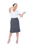 Surprised classy businesswoman holding newspaper Royalty Free Stock Images