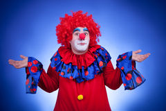 Surprised clown on blue background Stock Photos